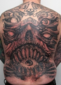 A large tattoo on her back demon
