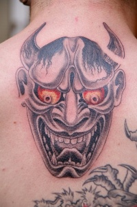 Asian demon with red eyes tattoo by fpista