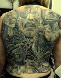 Awesome demons tattoo on whole back