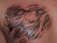 Demon face tattoo on chest by fpista