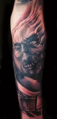 Demon tattoo on arm