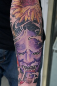 Demon tattoo on leg by graynd
