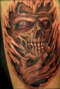 Demon underneath skin tattoo