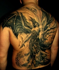 Fearful demon with great wings tattoo on back