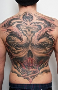 Tattoo on his back on the demonic theme